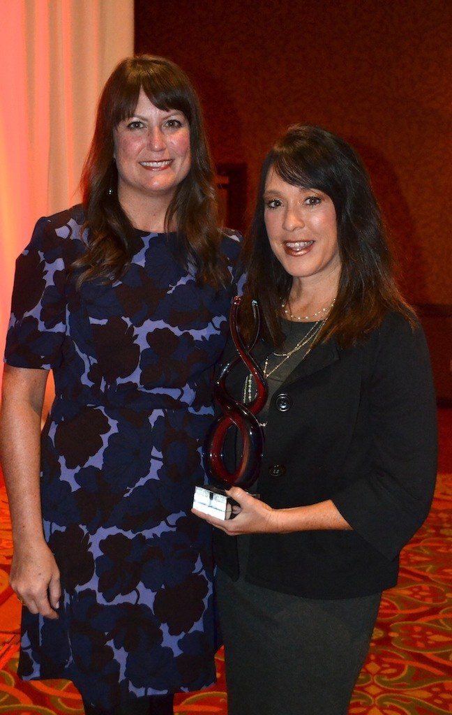 (from left) Brittany Duke presented the Duke Outstanding Service Award to Kim Lane, mediator for juvenile, domestic and probate cases.