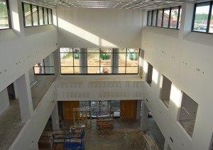 A view from the third floor and down into a portion of the eastern end of the main lobby where students are likely to gather between classes.