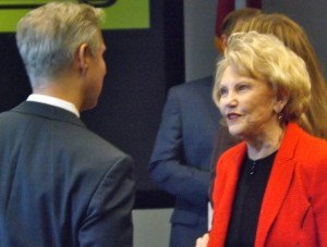 Johnelle Hunt, co-founder of J.B. Hunt Transport Services, visits with Mike Malone, the CEO of the Northwest Arkansas Council at the company's expansion plans announcement in Lowell on Wednesday (Dec. 9).