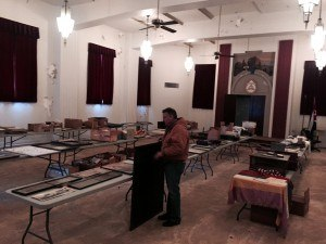 Four long rows of tables holds some of the documents, pictures and other items building owner Lance Beaty (pictured) hopes to organize and make available to the public.