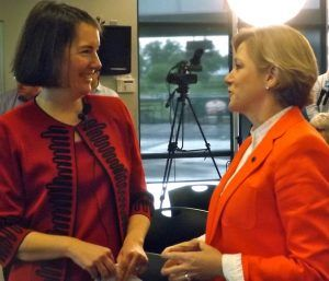 (from left) Kathleen McLaughlin, president of the Walmart Foundation and sustainability for Walmart, and Marcy Doderer, CEO of Arkansas Children's Hospital, talk prior to the $8 million gift reveal on Monday (May 10) in Springdale.