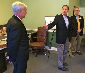 U.S. Sen. John Boozman, R-Ark. (center), gestures toward U.S. Rep. Steve Womack, R-Rogers (left), during a check presentation at the U.S. Marshals Museum office in downtown Fort Smith on May 7. Pictured at right is Jim Dunn, outgoing president and CEO of the U.S. Marshals Museum.