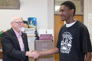 University of Arkansas Chancellor Joe Steinmetz visits Thursday (May 18) with Zabrian Mitchell, a student at Central High School in Helena-West Helena.