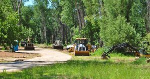 Clean up work has begun in Lee Creek Park, which sits adjacent to the Arkansas River near downtown Van Buren.