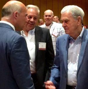 David Glass (far right), owner of the World Series Champions Kansas City Royals and former president and CEO of Wal-Mart Stores, visits with audience members at the 2016 Emerging Trends in Retail Conference held in Rogers on Tuesday (June 14).