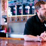 Jesse Core, owner of Springdale-based Core Brewing Co., at his retail store in Springdale.