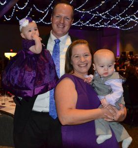 Dusty and Michelle Hurst with their 6-month old twins, Kanon Rockford and Remingon Ann. The Hurst family was the event's ambassador family.