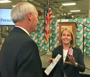 Cindi Marsiglio, vice president of U.S. Manufacturing for Bentonville-based Wal-Mart Stores, talks to Arkansas Gov. Asa Hutchinson on Monday after announcing Wal-Mart would buy Malibu Rum made at Pernod-Ricard's Fort Smith facility.