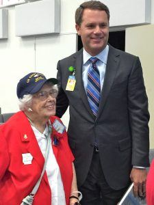 """Wal-Mart Stores CEO Doug McMillon and Lois Bouton, who served as a """"SPAR"""" with the U.S. Coast Guard between 1943-1945. SPARs comes from the Latin and English translations of the Coast Guard's motto, Semper Paratus! Always Ready!"""